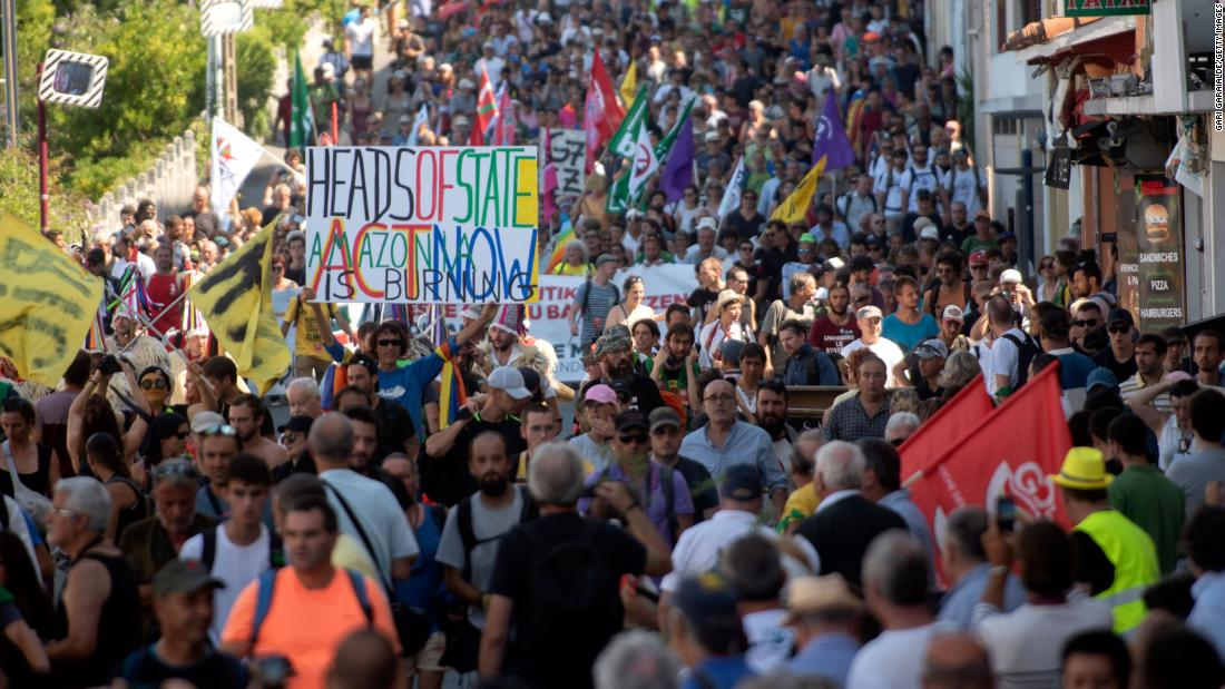 Thousands gather at G7 protests