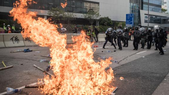Police retreat after clashing with protesters after a rally in Kwun Tong in Hong Kong on Saturday.