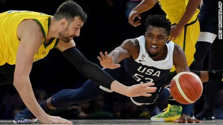Australia's Andrew Bogut, left, and United States' Donovan Mitchell, right, during Saturday's game.