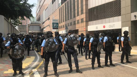 Police holding shields gather near a protest in Kwun Tong, Hong Kong, on August 24, 2019.