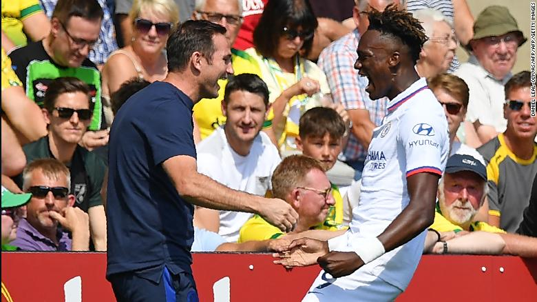 A landmark day: Frank Lampard (left) celebrates his first win with Chelsea striker Tammy Abraham