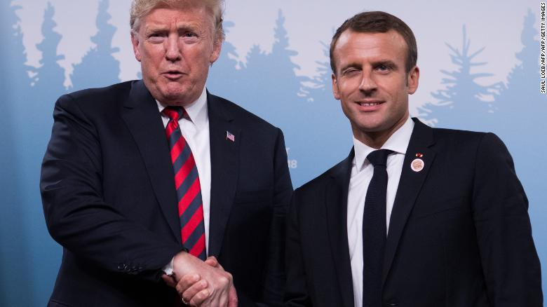 Presidents Trump and Macron shake hands before a meeting on Saturday.