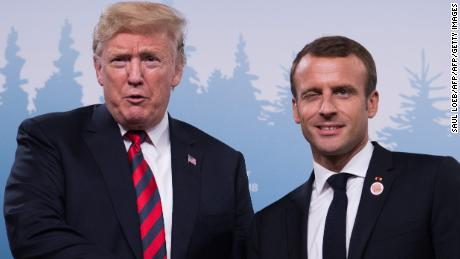 TOPSHOT - US President Donald Trump and French President Emmanuel Macron shake hands before a meeting on the sidelines of the G7 Summit in La Malbaie, Quebec, Canada, June 8, 2018. - They once shook hands for an eyewatering 29 seconds, with neither man willing to show any hint of weakness. Now Emmanuel Macron has left a firm impression on Donald Trump in their latest squeezing contest. (Photo by SAUL LOEB / AFP)        (Photo credit should read SAUL LOEB/AFP/Getty Images)