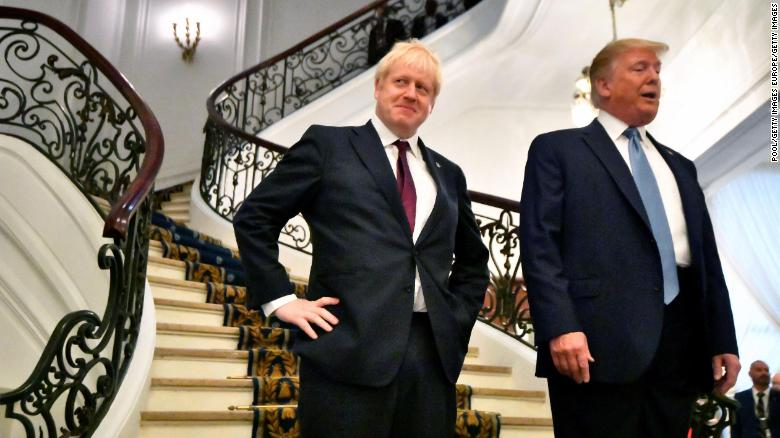 US President Donald Trump and Britain's Prime Minister Boris Johnson arrive for a breakfast meeting during the G7 on Sunday.