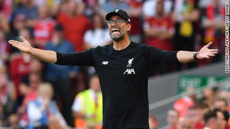 Liverpool's German manager Jurgen Klopp gestures on the touchline during the English Premier League football match between Liverpool and Arsenal at Anfield in Liverpool, north west England on August 24, 2019. (Photo by Ben STANSALL / AFP) / RESTRICTED TO EDITORIAL USE. No use with unauthorized audio, video, data, fixture lists, club/league logos or 'live' services. Online in-match use limited to 120 images. An additional 40 images may be used in extra time. No video emulation. Social media in-match use limited to 120 images. An additional 40 images may be used in extra time. No use in betting publications, games or single club/league/player publications. /         (Photo credit should read BEN STANSALL/AFP/Getty Images)