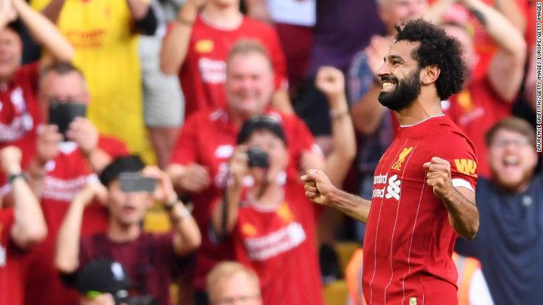 Mohamed Salah scored twice against Arsenal to move Liverpool top of the table
