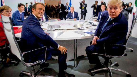 French President Emmanuel Macron, left, and President Donald Trump, right, participates in a G-7 Working Session on the Global Economy, Foreign Policy, and Security Affairs the G-7 summit in Biarritz, France, Sunday, Aug. 25, 2019. Also pictured is German Chancellor Angela Merkel, left, Canadian Prime Minister Justin Trudeau, second from left, and President of the European Council Donald Tusk, center. (AP Photo/Andrew Harnik, Pool)