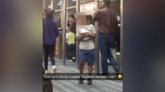 Kristen Dundas posted about a flight delay that became enjoyable when Southwest staff started playing contests and games with travelers. CNN blurred the face of this child, who took part in a paper airplane contest at the gate.