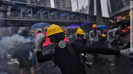 Protesters and police exchange tear gas in Tseun Wan in Hong Kong on August 25, 2019.