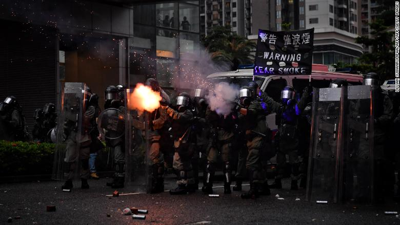 Police fire tear gas in Tseun Wan in Hong Kong on August 25, 2019 in the latest opposition to a planned extradition law that has since morphed into a wider call for democratic rights in the semi-autonomous city.