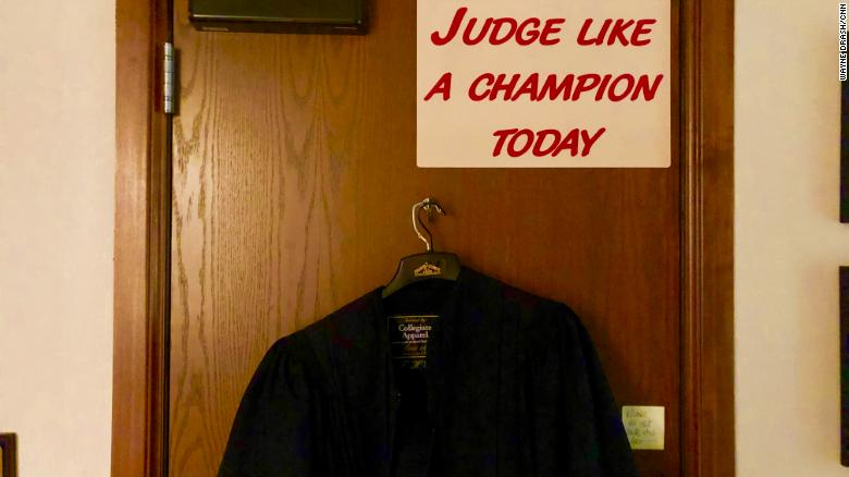 The nearby University of Oklahoma football team has a sign like this in their locker room. Balkman touches it every time he enters court.