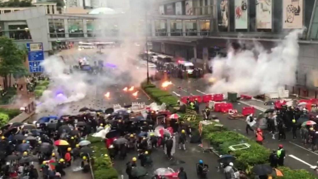 A gun shot, petrol bombs and water cannons mark violent escalation in Hong Kong protests