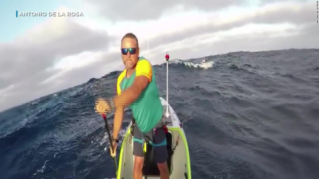 Man's paddleboard trip across Pacific breaks record