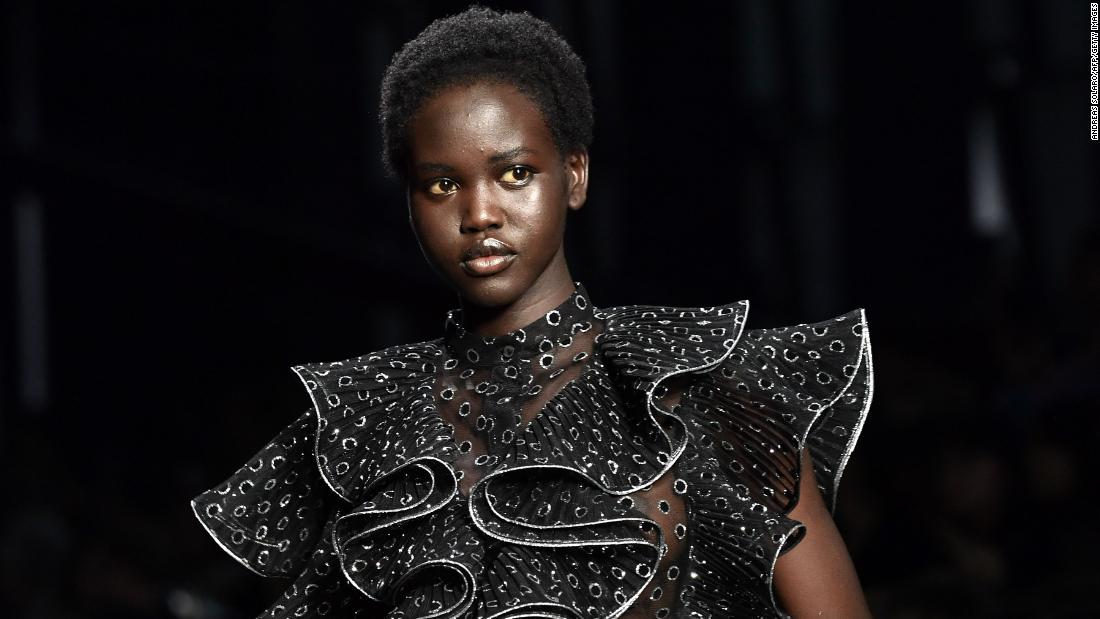 "<a href=""https://time.com/collection/time-100-next-2019/5718883/adut-akech/"" target=""_blank"">Adut Akech</a> is a South Sudanese-Australian model. She was a <a href=""https://edition.cnn.com/style/profiles/adut-akech"" target=""_blank"">former child refugee </a>who spent the first eight years of her life in Kenya's Kakuma refugee camp before migrating to Australia."