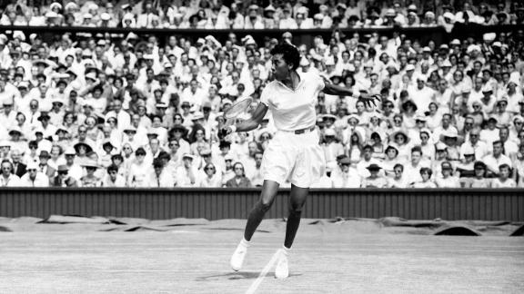 In this 1957 photo, Althea Gibson makes a return to Darlene Hard during their WImbledon Championship match. Gibson won 6-3, 6-2.