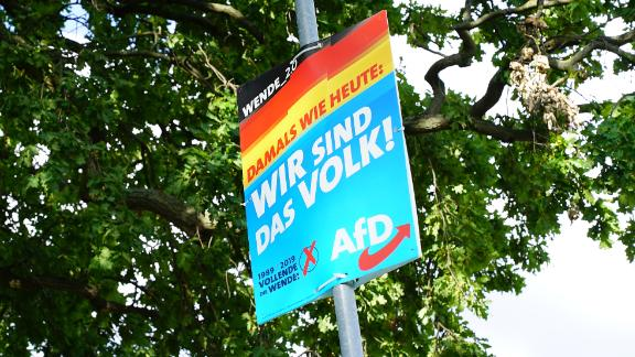 """A roadside AfD poster in eastern Germany with the famous 1989 slogan: """"We are the People!"""""""