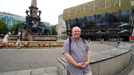 Saxony AfD candidate Jörg Küne sits on the square where he joined the demonstrations for freedom 30 years ago.