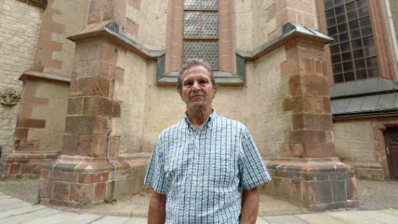 Retired pastor Christophe Wonneberger outside St. Nicholas Church, where the weekly demonstrations began.