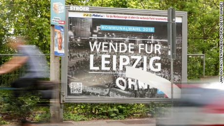 An AfD billboard with a photo of the 1989 Leipzig protests, taken by Martin Neuhof's grandfather.