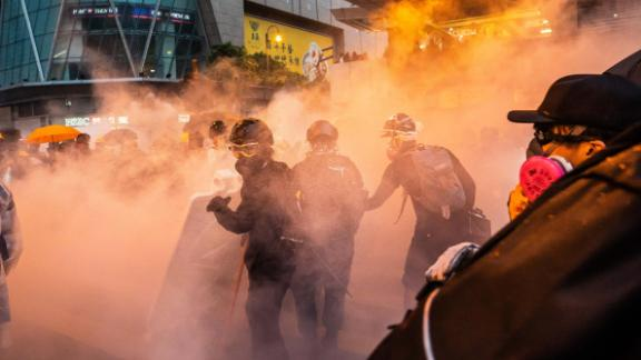 Protesters clash with police after a rally in Hong Kong