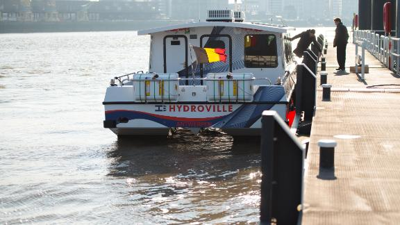The Hydroville berthed at the Scheldt River, ready to embark passengers.