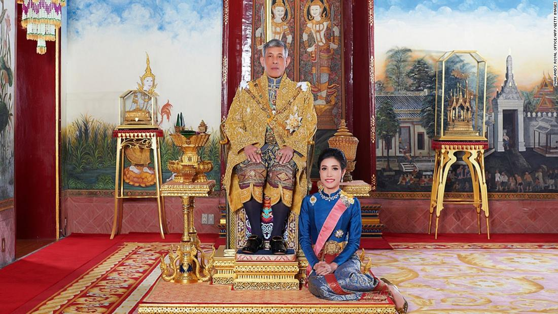 Thai King strips 'disloyal' royal consort of titles and military ranks