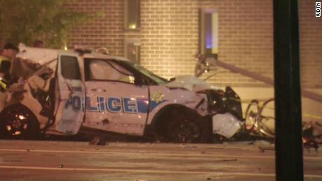 2 dead, 9 injured after stolen police car crashes
