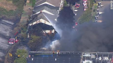 Firefighters battle flames in the Madison South neighborhood of Portland, Oregon.