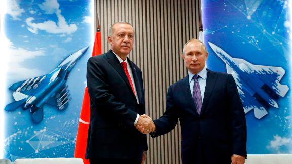 Turkish President Recep Tayyip Erdogan (L) shakes hands with his host Russian President Vladimir Putin as they visit the MAKS-2019 International Aviation and Space Salon opening day in Zhukovsky outside of Moscow on August 27, 2019. (Photo by Maxim SHIPENKOV / POOL / AFP)        (Photo credit should read MAXIM SHIPENKOV/AFP/Getty Images)
