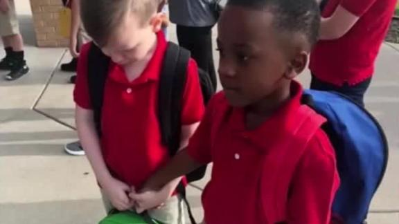 Image for When a boy with autism was overwhelmed on the first day of school, another little boy held his hand
