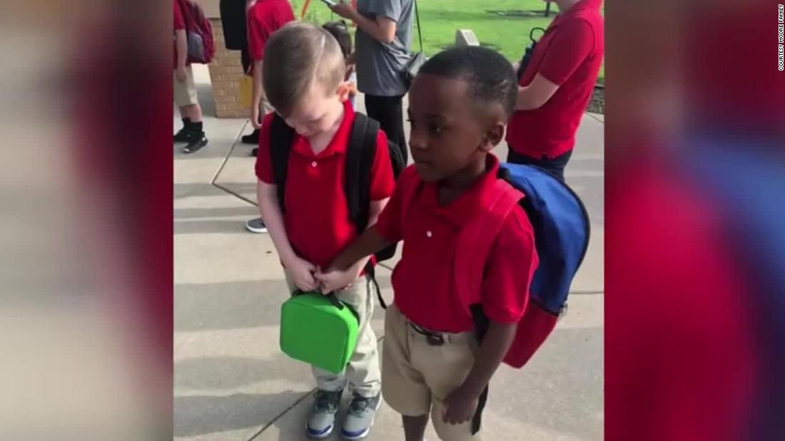 Photo of boy calming child with autism will warm your heart