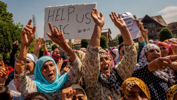Kashmiri Muslim women shout anti Indian slogans during an anti Indian protest, on August 23, 2019 in Srinagar.