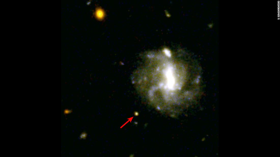 A kilanova was captured by the Hubble Space Telescope in 2016, seen here next to the red arrow. Kilanovae are massive explosions that create heavy elements like gold and platinum.