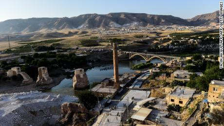 A view of the construction work along the Tigris River that runs through the 12,000-year-old Hasankeyf settlement and ancient citadel town which will soon be significantly submerged by the waters of the nearby Ilisu dam in southeastern Turkey, on July 29, 2018. - The Turkish town of Hasankeyf, a former trading post along the Silk Road, which has seen the Romans, Byzantines, Turkic tribes and Ottomans leave their mark, will soon be partially flooded by the Ilisu Dam, as part of the Southeast Anatolian project (Gap) and one of Turkeys largest hydroelectric projects, which is being built down stream. The inauguration of Turkey's controversial Ilisu dam on the Tigris River will also compound water shortages in neighbouring Iraq. (Photo by Yasin AKGUL / AFP) (Photo credit should read YASIN AKGUL/AFP/Getty Images)