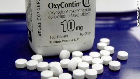 FILE - This Feb. 19, 2013 file photo shows OxyContin pills arranged for a photo at a pharmacy in Montpelier, Vt. Connecticut-based Purdue Pharma, the maker of the powerful painkiller OxyContin has agreed to provide access to propriety research and other data to addiction researchers at Oklahoma State University to help them find causes and treatments for drug addiction. (AP Photo/Toby Talbot, File)