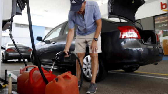 People were stocking up on gasoline, water and other supplies Tuesday in Ponce, Puerto Rico.