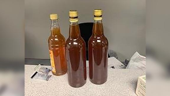 Evidence: three bottles of honey.
