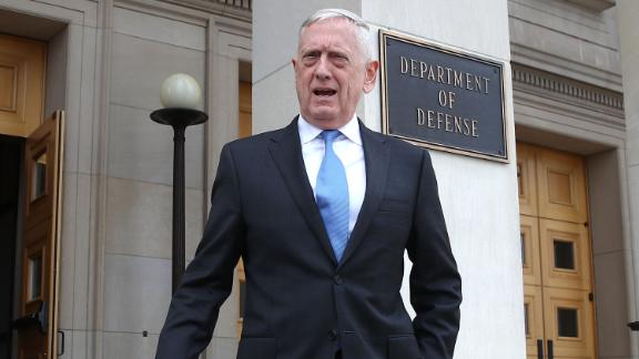U.S. Secretary of Defense Jim Mattis walks to greet incoming National Security Advisor John Bolton upon Bolton