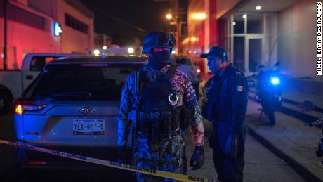 Federal police at the scene following the deadly fire in Coatzacoalcos.