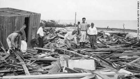 Rescue workers search for  victims of the Labor Day Storm in 1935.