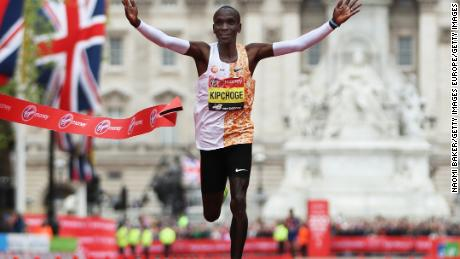 Eliud Kipchoge crosses the finish line during the London Marathon