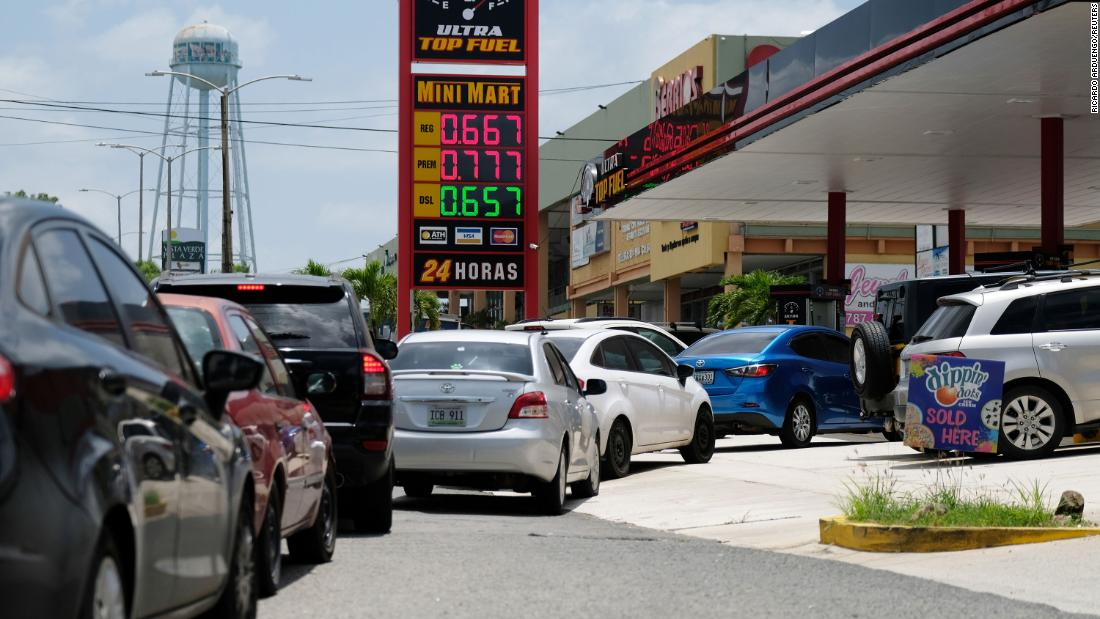 Cars line up for fuel at a gas station in Mayaguez, Puerto Rico, on August 27.