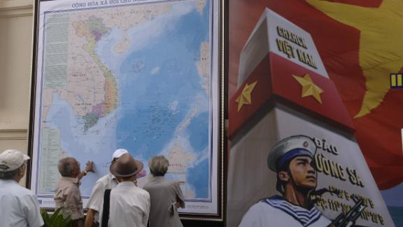 Men look at an official map of Vietnam as they visit an exhibition on archipelagos Truong Sa (Spratlys) and Hoang Sa (Paracels) at the Army Museum in Hanoi on July 10, 2013. Vietnamese authorities have recently intensified propaganda on its sovereignty of the Spratlys and Paracels islands in the South China Sea currently claimed by Vietnam, China, Taiwan, Philippines and Malaysia.  AFP PHOTO/HOANG DINH Nam / AFP / HOANG DINH NAM        (Photo credit should read HOANG DINH NAM/AFP/Getty Images)