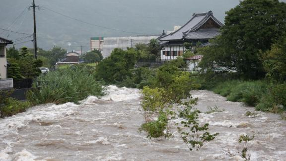 Rising water caused by heavy rain is seen at Muromi river in Fukuoka on August 28, 2019.
