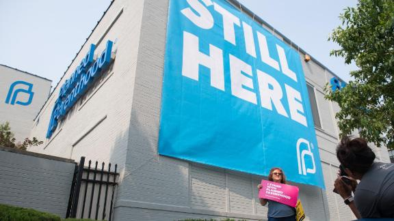 Pro-choice supporters pose for photos outside the Planned Parenthood Reproductive Health Services Center in St. Louis, Missouri, May 31, 2019, the last location in the state performing abortions, after a US Court announced the clinic could continue operating. - A US Court on May 31, 2019 blocked Missouri from closing the clinic. (Photo by SAUL LOEB / AFP)        (Photo credit should read SAUL LOEB/AFP/Getty Images)