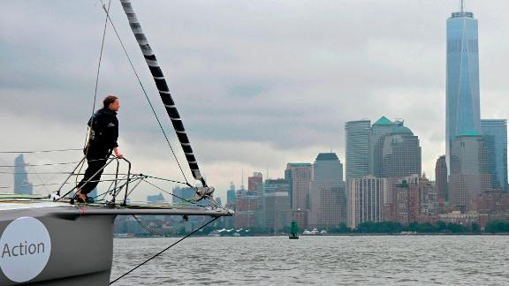 """The Malizia II, a zero-carbon yacht, with Swedish climate activist Greta Thunberg, 16, arrives in the US after a 15-day journey crossing the Atlantic in on August 28, 2019 in New York. - """"Land!! The lights of Long Island and New York City ahead,"""" she tweeted early Wednesday. She later wrote on Twitter that her yacht had anchored off the entertainment district of Coney Island in Brooklyn to clear customs and immigration. (Photo by Johannes EISELE / AFP) / ALTERNATIVE CROP        (Photo credit should read JOHANNES EISELE/AFP/Getty Images)"""