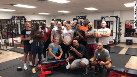 College football players shave their heads to support coach battling cancer