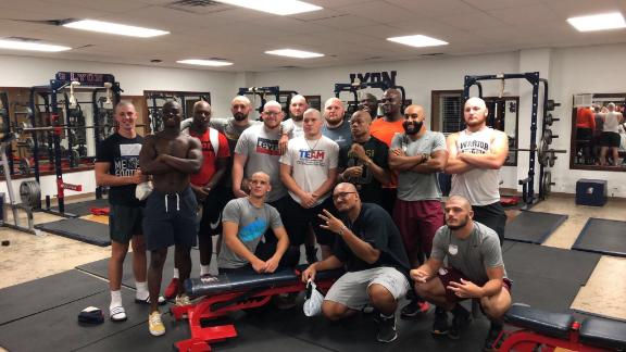 The players at Lyon College in Batesville, Arkansas, show off their shaved heads in the weight room.