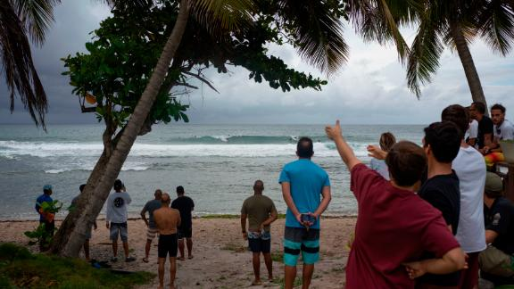 People gather at the coast in Patillas, Puerto Rico, on Wednesday as Dorian neared.