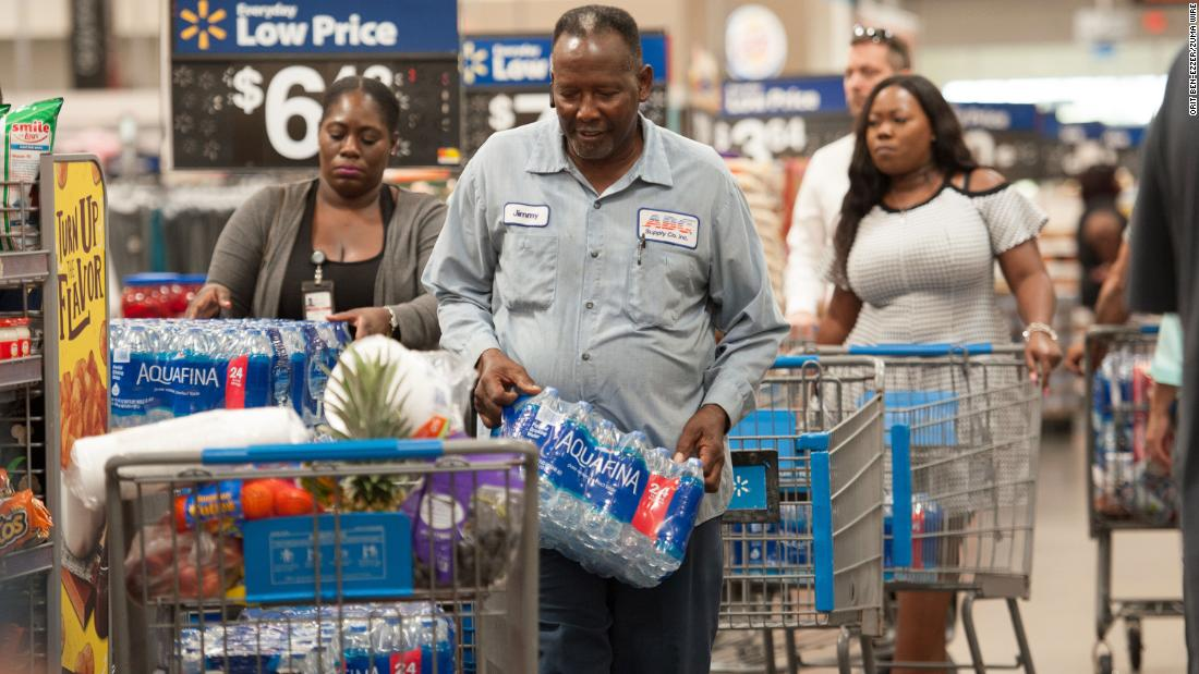 People stock up with groceries and water in Fort Lauderdale, Florida, on August 28.